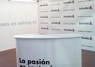 Montaje de lonas y stand publicitario para Helvetia